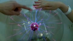 Hands at Plasma globe Stock Footage