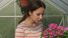 Young woman smeling flowers Stock Footage