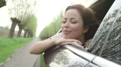 Young woman sitting in car - stock footage