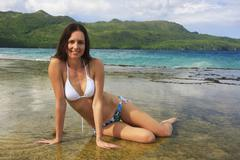 Young woman in bikini sitting at rincon beach, samana peninsula Stock Photos