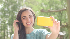 Woman taking self portrait with phone camera Stock Footage