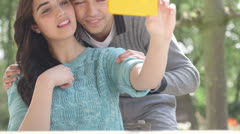Couple taking self portrait with phone camera Stock Footage