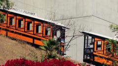 A funicular tram and cable car, transports people in Los Angeles Stock Footage