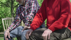 Senior men sitting in park - stock footage