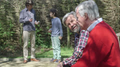 Grandfather with son and grandson in park Stock Footage