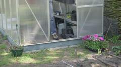 Men working in domestic garden Stock Footage