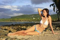 young woman in bikini sitting at las galeras beach, samana peninsula - stock photo