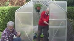 Senior, mature men working in garden Stock Footage