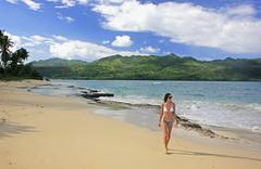 Young woman in bikini walking at rincon beach, samana peninsula Stock Photos