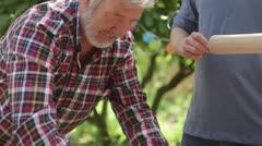 Men cooking food in domestic garden Stock Footage