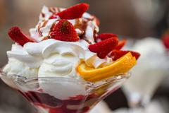 Delicious vanilla sundae with strawberry Stock Photos