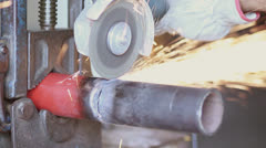 Sawing  an iron pipe Stock Footage