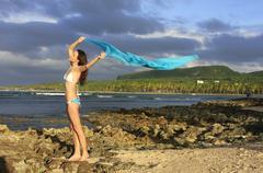 young woman in bikini standing at las galeras beach, samana peninsula - stock photo