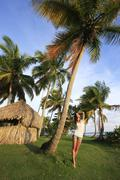 young woman standing at las galeras beach, samana peninsula - stock photo