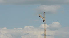 A lone tower crane in a beautiful cloudy sky. time lapse Stock Footage