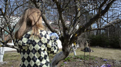 Blond woman hand cut prune fruit tree branch hand saw spring Stock Footage