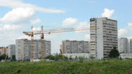 Construction of the building on background moving clouds in Moscow area Stock Footage