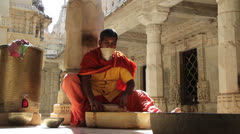 India Rajasthan Ranakpur Jain temple artisan with mask scraping  Stock Footage