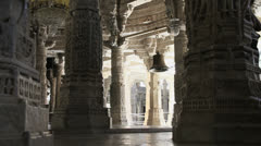 India Rajasthan Ranakpur Jain temple bell suspended between columns 28 Stock Footage