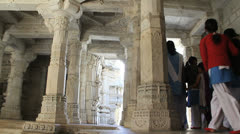 India Rajasthan Ranakpur Jain temple visitors pass carved columns 26 Stock Footage
