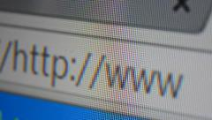 http www address bar. close up of mouse cursor typing in web browser address - stock footage