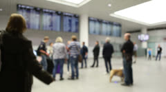 Airport arrivals hall with people - stock footage