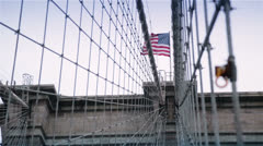The American Flag on the Top of Brooklyn Bridge, New York Stock Footage