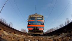 Train is arriving to the station. Under train view Stock Footage