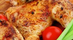 Grilled quarter chicken Stock Footage