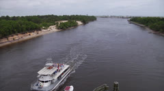 Party barge glides under bridge on waterway b, ship passes, 60fps Stock Footage