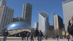 Tourists visit Cloud Gate by day, The Bean, Chicago, Illinois, USA Stock Footage