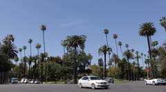 Car Traffic in Beverly Hills, Palm Trees near Santa Monica BLVD, Los Angeles USA Stock Footage