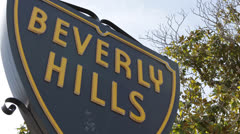Beverly Hills Sign symbol luxury Street Sign, Los Angeles, California, Blue Sky Stock Footage