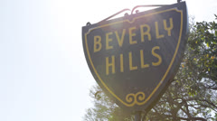 Beverly Hills Sign, Palm Trees, Street Sign, Los Angeles, California, Blue Sky - stock footage