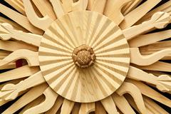 carving in the shape of sun in oriental style - stock photo