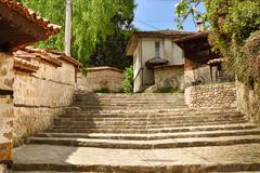 A traditional old street in koprivshtitsa bulgaria, from the time of the otto Stock Photos