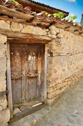 an old wooden door in koprivshtitsa bulgaria, from the time of the ottoman em - stock photo