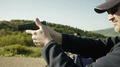 Shooting a pistol Stock Footage
