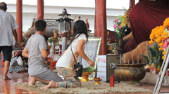 Husband And Wife Paying Respect At Buddhist Temple Stock Footage