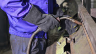 Stock Video Footage of Welding operator welds with torch at welding-site