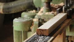 Wooden bar comes from wood grinding machine, dolly shot Stock Footage