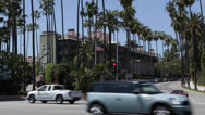 Stock Video Footage of Beverly Hills Hotel, Palm Trees, Car Traffic, Sunset Boulevard, Los Angeles, USA