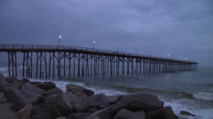 Pier and waves at dusk 2, 12fps Stock Footage