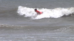frenetic surfer from beach - stock footage