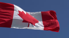 National Flag of Canada, the Maple Leaf waving in blue sky Stock Footage