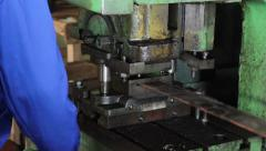 Factory repetitive moves, male stamping holes in iron steel bar - stock footage