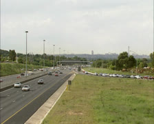 Commuting traffic at highway junction in suburb Johannesburg, South Africa Stock Footage