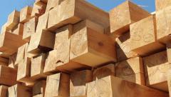 Stack of square wooden chips at construction yard. Dolly pan shot, blue sky Stock Footage
