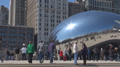 Pan right of Cloud Gate by day, The Bean, Chicago, Illinois, USA Stock Footage