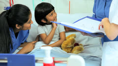 Multi Ethnic Nursing Staff Recording Child Patient Treatment Stock Footage